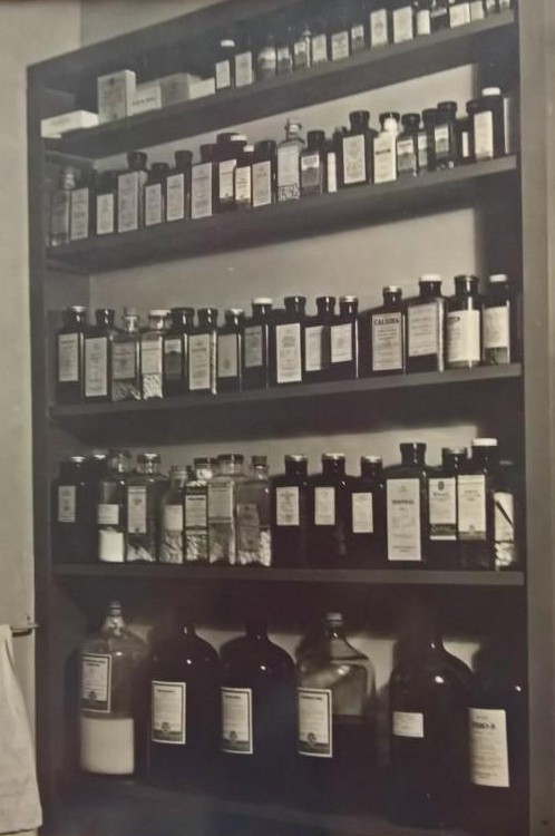 An old fashioned office pharmacy in black and white